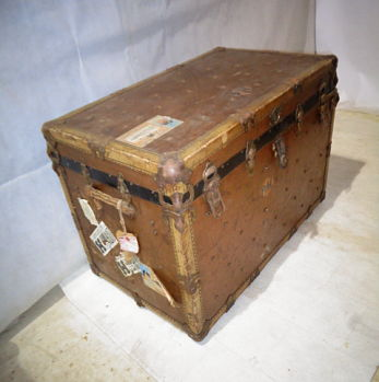 VINTAGE LEATHER COVERED STEAMER TRUNK